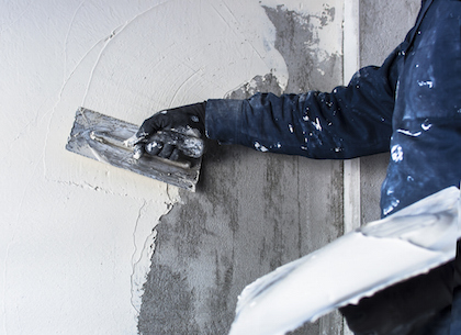 Construction site - Worker performs internal plaster